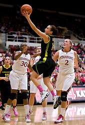 February 18, 2010; Stanford, CA, USA; Oregon Ducks guard Taylor Lilley (1) shoots past Stanford Cardinal forward Nnemkadi Ogwumike (30) and forward/center Jayne Appel (2) during the first half at Maples Pavilion. Stanford defeated Oregon 104-60.