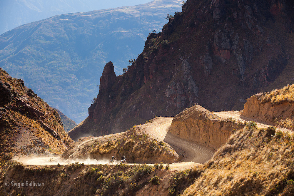 Rugged, twisty dirt roads cut through the Cordillera Quimsa Cruz, Bolivia.