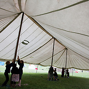 The biggest tent, the main marquee is raised. Reclaim the Power camp is set up in a field near Balcombe. The site is squatted but so far nor the owner nor police has made any moves to stop the camp from setting up. It is organised by the environmental group No Dash for Gas and the movement is protesting against the company Cuadrilla's fracking testing near Balcombe and have come to Balcombe to len its support to the local protests against the drilling for gas.