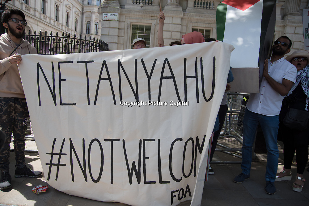 Pro-Palestinian Protest Netanyahu visiting downing street to meet Theresa May. No Israeli War Criminals Here - Free Palestine! June 6 2018, London, UK.