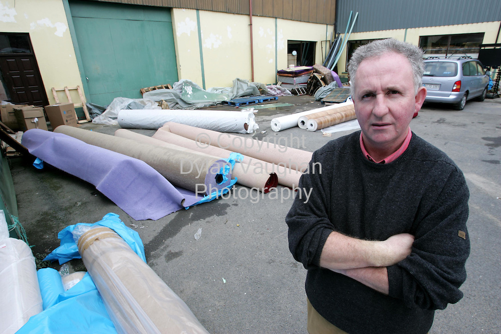 2/11/2004.Adrian Fox pictured at Fitzgerald Nash in Clonmel with flood damaged stock..Picture Dylan Vaughan