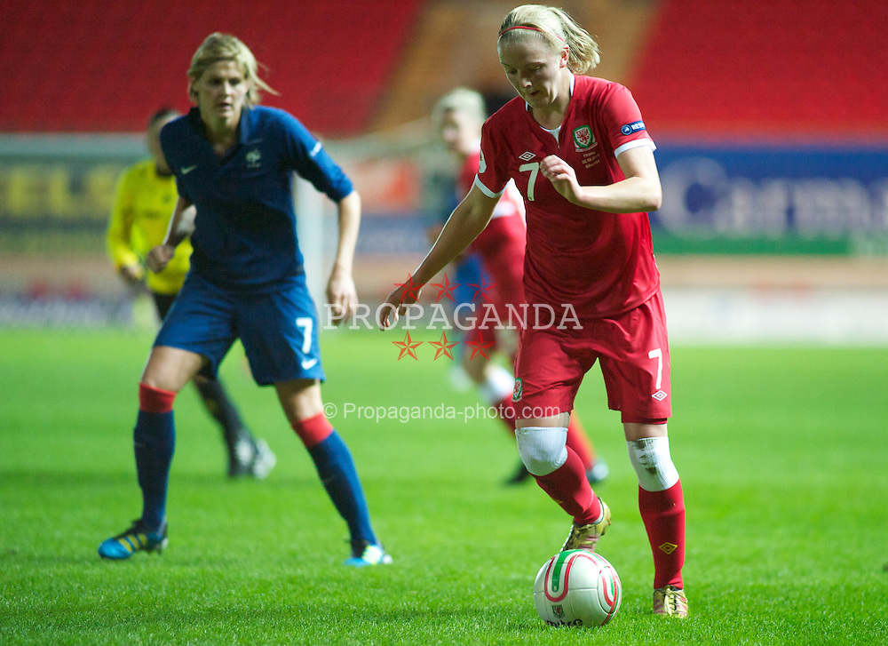 LLANELLI, WALES - Saturday, October 22, 2011: Wales' Helen Bleazard in action against France's Corine Franco during the UEFA Women's EURO 2013 Qualifying Group 4 at Parc Y Scarlets. (Pic by Gareth Davies/Propaganda)