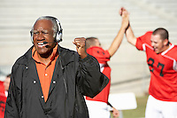 Football coach shouting and pumping fist on sideline