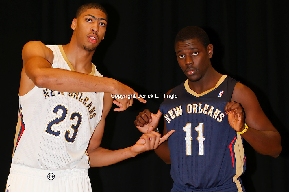 Aug 1, 2013; Metairie, LA, USA; New Orleans Pelicans forward Anthony Davis (23) with guard Jrue Holiday (11) during a uniform unveiling at the team practice facility. Mandatory Credit: Derick E. Hingle-USA TODAY Sports