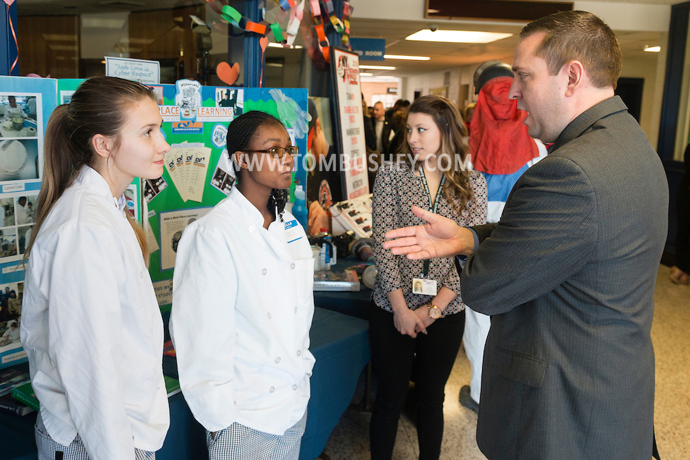 Goshen, New York - Orage County Executive Steve Neuhaus speaks to culinary students Bridget McGill of Warwick, left,  and Destiny Demoney of Pine Bush during the Orange-Ulster BOCES CTE (Career and Technical Education) program held its media day on Feb. 18. 2016.