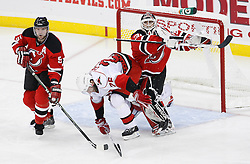 Apr 23, 2009; Newark, NJ, USA; New Jersey Devils goalie Martin Brodeur (30) shoves Carolina Hurricanes right wing Erik Cole (26) during the third period of game five of the eastern conference quarterfinals of the 2009 Stanley Cup playoffs at the Prudential Center. The Devils beat the Hurricanes 1-0 to take a 3-2 lead in the best of 7 series.
