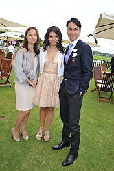 Left to right, LIUDMILA LE TROQUER, KATIE MELUA and FRANCOIS LE TROQUER at the Cartier Queen's Cup Polo Final, Guards Polo Club, Windsor Great Park, Berkshire, on 17th June 2012.