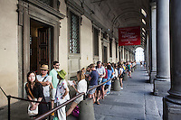 FLORENCE, ITALY - 29 JUNE 2016: Visitors are here in line to purchase a ticket at the Uffizi Gallery in Florence, Italy, on June 29th 2016.<br /> <br /> Art historian Eike Schmidt, former curator and head of the Department of Sculpture, Applied Art and Textiles at the Minneapolis Institute of Arts, became the first non-Italian director of the Uffizi in August 2015, replacing Antonio Natali who directed the gallery for 9 years. One of the main goals of the new director is to open the Vasari Corridor to the general public. Currently the corridor can only be visited with group reservations made by external tour and travel agencies throughout the year.<br /> <br /> The Vasari Corridor is is a 1-kilometer-long (more than half mile) elevated enclosed passageway which connects the Palazzo Vecchio with the Palazzo Pitti, passing through the Uffizi Gallery and crossing the Ponte Vecchio above the Arno River, in Florence. The passageway was designed and built in 1564 by Giorgio Vasari in only 6 months to allow Cosimo de' Medici and other Florentine elite to walk safely through the city, from the seat of power in Palazzo Vecchio to their private residence, Palazzo Pitti. The passageway contains over 1000 paintings, dating from the 17th and 18th centuries, including the largest and very important collection of self-portraits by some of the most famous masters of painting from the 16th to the 20th century, including Filippo Lippi, Rembrandt, Velazquez, Delacroix and Ensor.