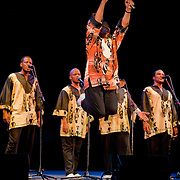 Ladysmith Black Mambazo founder and leader Joseph Shabalala leaps into the air at The Music Hall, Portsmouth, NH
