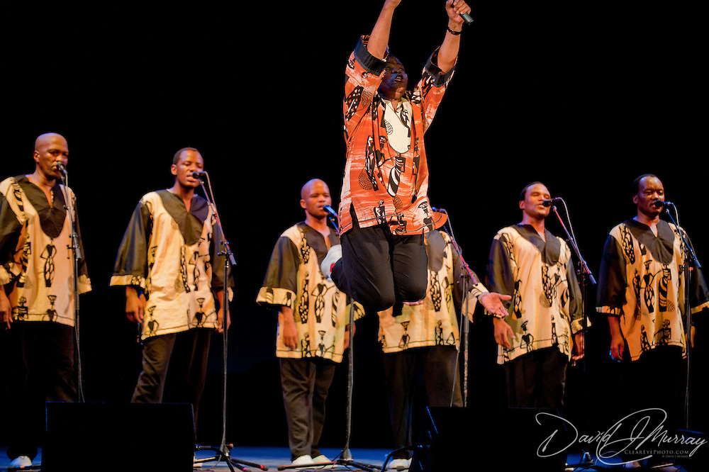Ladysmith Black Mambazo founder and leader Joseph Shabalala leaps into the air at The Music Hall, Portsmouth, NH