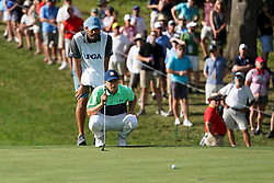 August 9, 2018 - St. Louis, Missouri, United States - Jordan Spieth (R) and his caddie Michael Greller line up a putt during the first round of the 100th PGA Championship at Bellerive Country Club. (Credit Image: © Debby Wong via ZUMA Wire)