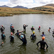 Competitors in the water in preparation for the race start during the Active Q T Ultimate Tri Series Jack's Point Triathlon, Jack's Point,  Queenstown, Otago, New Zealand. 14th January 2012. Photo Tim Clayton