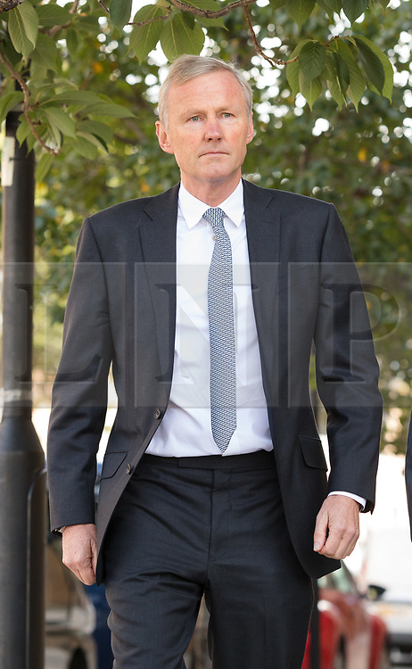 © Licensed to London News Pictures. 28/09/2018. London, UK.  Clive Schlee, CEO of Pret a Manger leaving West London Coroner's Court with a photograph of Natasha Ednan-Laperouse following the inquest into the death of Natasha Ednan-Laperouse. Natasha Ednan-Laperouse, aged 15, died on a British Airways flight to from London to Niece, when she fell ill after eating a Pret a Manger sandwich believed to contain sesame.  Photo credit: Vickie Flores/LNP