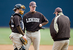 Lehigh pitcher Andrew Berger and catcher Billy Swenson meet at the mound.  The #17 ranked Virginia Cavaliers baseball team defeated the Lehigh Mountain Hawks 12-1 at the University of Virginia's Davenport Field in Charlottesville, VA on February 24, 2008.