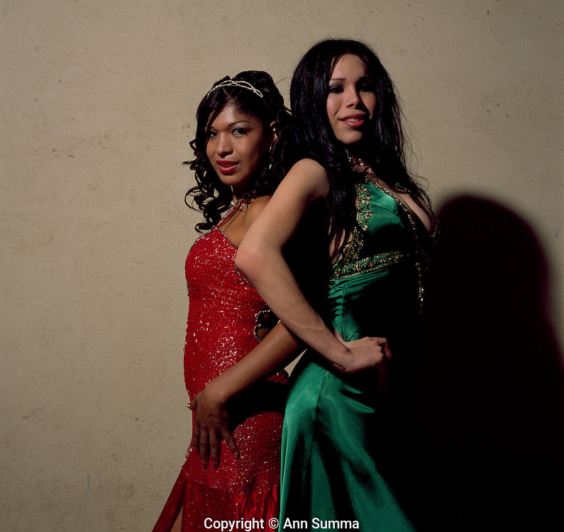 """Juchitan, Mexico: Transvestite beauty queens pose back stage at a """"vela,"""" or party, held by the muxe group """"Authenic Inrepid Seekers of Dangers"""" (or Las Intrepidas) in Juchtan, Mexico.  Mariela Guzman? (green dress) and Yesica Ninel (red dress). Nov. 22, 2008 (photo: Ann Summa)."""