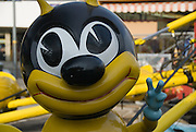Part of a ride for children, a bumble bee gives a peace sign at the now-closed Astroland amusement park at Coney Island in Brooklyn, New York.