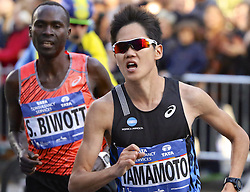 November 6, 2016 - New York, New York, U.S - HIROYUKI YAMAMOTO of Japan and ShADRACK BIWOTT of the U.S. race on 59th Street in Manhattan in the New York City Marathon.  They would finish 4th and 5th, respectively (in times of 2:11:49 and 2:12:01) in the men's division of the race. (Credit Image: © Staton Rabin via ZUMA Wire)