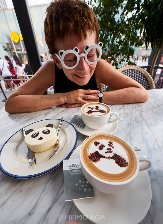 China, Sichuan. Chengdu. IFS Mall (Chengdu International Finance Square) is famous for the giant panda sculpture climbing up its wall. In the rooftop café next to it, they serve panda cakes and cappuccinos.