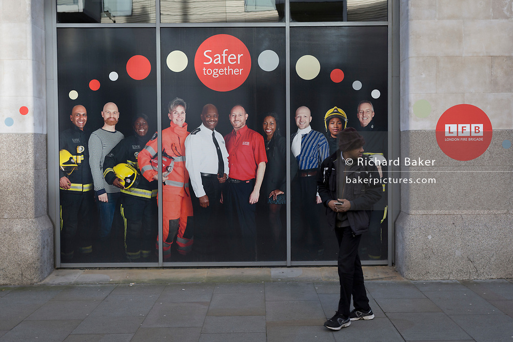 A poster featuring staff with the London Fire Brigade (LFB) outside their headquarters in Southwark, on 30th January 2018, in London, England.