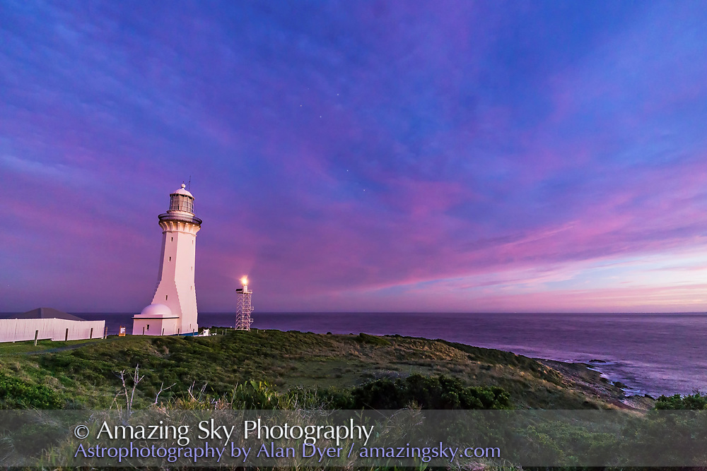 The Southern Cross and the Pointer Stars appearing amid the sunset twilight over the Green Cape Lighthouse, New South Wales, Australia. This was March 29, 2017, with these stars rising into the southeast. The working beacon is the smaller structure at right. The old tower was decommissioned in the 1980s. Taken as part of a 780-frame time-lapse sequence.