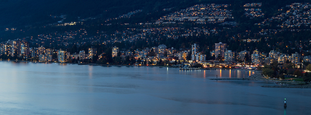 Evening view of waterfront condo/apartment towers along the shore of English Bay in West Vancouver, British Columbia, Canada.  Photographed from Prospect Point in Vancouver's Stanley Park.