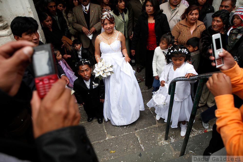 People take pictures of couple Crescencio Choque, center left and  Isabel Lorena after they get married in the city of La Paz, Saturday, Dec. 19, 2009.
