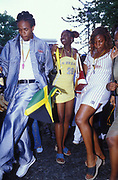 Girls and boys dancing in the street, Notting Hill Carnival, UK  2003