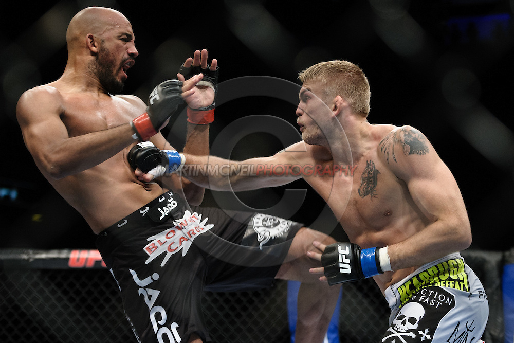 "LONDON, ENGLAND, OCTOBER 2010:  Cyrille Diabate (left) is stopped in his tracks by a punch from Alexander Gustafsson during ""UFC 120: Bisping vs. Akiyama"" inside the O2 Arena in Greenwich, London"