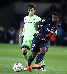 Serge Aurier of Paris Saint-Germain is put under pressure by David Silva of Manchester City - Mandatory by-line: Robbie Stephenson/JMP - 06/04/2016 - FOOTBALL - Parc des Princes - Paris,  - Paris Saint-Germain v Manchester City - UEFA Champions League Quarter Finals First Leg