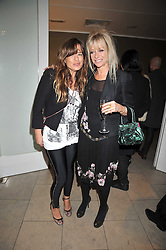 Left to right, JADE JAGGER and JO WOOD at the MAC Salutes party paying tribute to renowned makeup artists held at The Hosptal, Endell Street, London on 22nd February 2009.