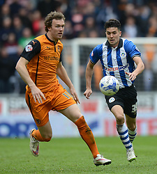 Wolverhampton Wanderers' Kevin McDonald competes with Wigan's Tim Chow - Photo mandatory by-line: Richard Martin-Roberts/JMP - Mobile: 07966 386802 - 25/04/2015 - SPORT - Football - Wigan - DW Stadium - Wigan Athletic v Wolverhampton Wanderers - Sky Bet Championship