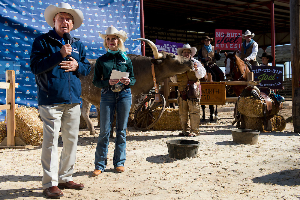 Dick Vitale and Joel, the longhorn, go head-to-head in an NCAA tournament bracket pick 'em contest at the Stockyards in Fort Worth, Texas on March 18, 2014. (Cooper Neill)