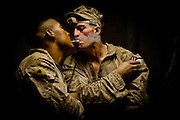 Lance Corporal John Bohlinger, right, lights a cigarette off of Corporal Manuel Mendoza's.