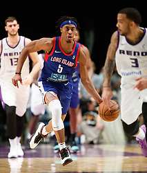 November 19, 2017 - Reno, Nevada, U.S - Long Island Nets Guard TAHJERE MCCALL (5) drives against Reno Bighorns Guard MARCUS WILLIAMS (3) during the NBA G-League Basketball game between the Reno Bighorns and the Long Island Nets at the Reno Events Center in Reno, Nevada. (Credit Image: © Jeff Mulvihill via ZUMA Wire)