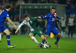 OSIJEK, CROATIA - Tuesday, October 16, 2012: Wales' Gareth Bale in action against Croatia's Ivan Perisic during the Brazil 2014 FIFA World Cup Qualifying Group A match at the Stadion Gradski Vrt. (Pic by David Rawcliffe/Propaganda)