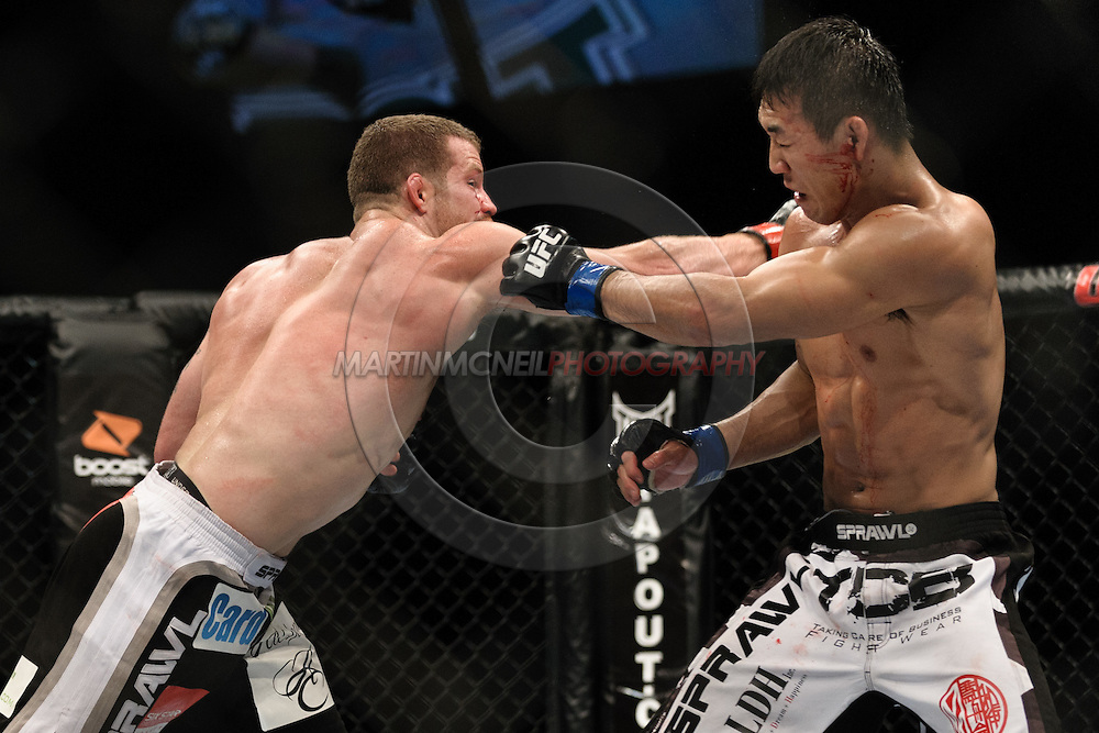 OBERHAUSEN, GERMANY, NOVEMBER 13, 2010: Yushin Okami and Nate Marquardt during UFC 122 inside the Konig Pilsner Arena in Oberhausen, Germany.
