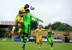 Ellis Harrison of Bristol Rovers climbs highest to win a header from Emmanuel Monthe of Forest Green Rovers - Mandatory by-line: Paul Roberts/JMP - 22/07/2017 - FOOTBALL - New Lawn Stadium - Nailsworth, England - Forest Green Rovers v Bristol Rovers - Pre-season friendly