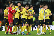 Millwall players celebrate after the 1 - 0 win over Derby County during the EFL Sky Bet Championship match between Derby County and Millwall at the Pride Park, Derby, England on 14 December 2019.