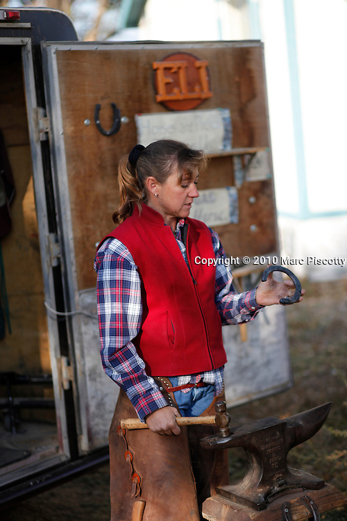 """SHOT 10/11/10 9:12:09 AM - Mother and daughter ferriers """"Eli"""" (short for Elizabeth) and Rachel Hoyt, 14, of Diamond E Horseshoeing in La Salle, Co. """"Eli"""" has been shoeing horses for more than 20 years and has brought her daughter in to help out during the summertime but Rachel isn't so sure that becoming a full-time ferrier is in her future. She said she's interested in studying forensic science in college. Elizabeth goes by """"Eli"""" because the profession is still very male dominated. (Photo by Marc Piscotty / © 2010)"""