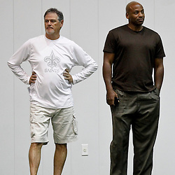 July 27, 2012; Metairie, LA, USA; New Orleans Saints general manager Mickey Loomis who also will be in charge of basketball operations for the New Orleans Hornets franchise talks with their general manager Dell Demps on the sideline during training camp at the team's indoor practice facility. Mandatory Credit: Derick E. Hingle-US PRESSWIRE