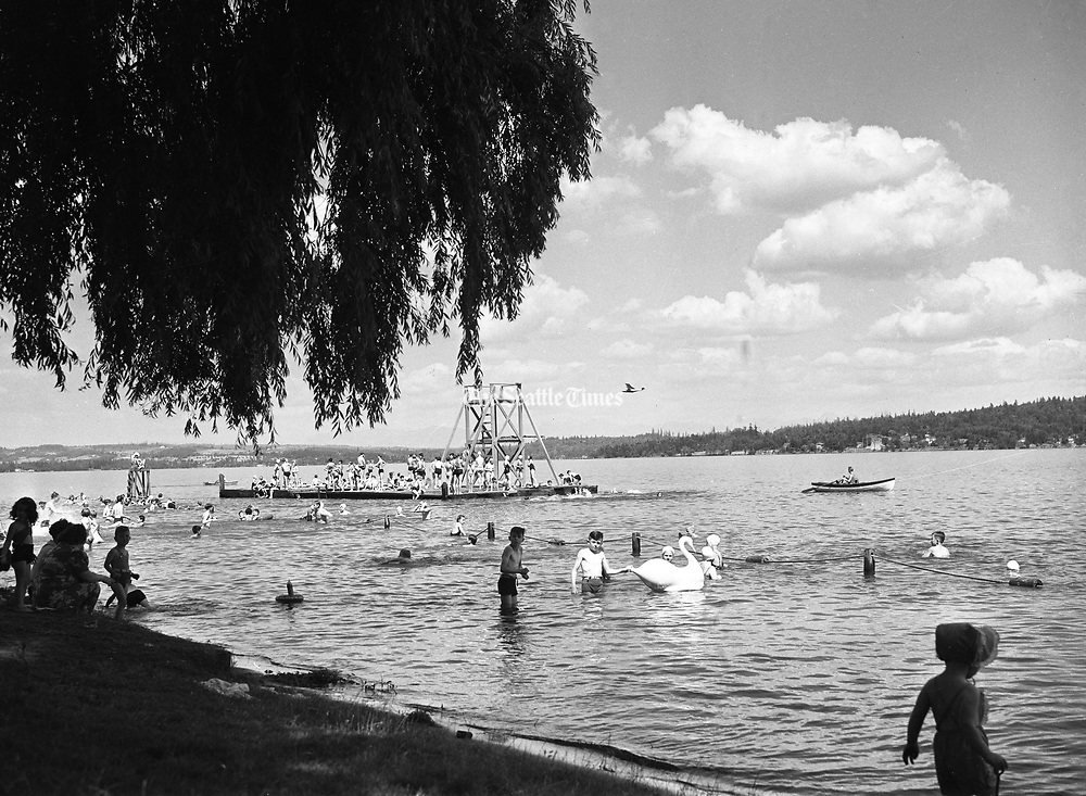Children enjoy the water on a sunny day at Madrona Beach on Lake Washington in July, in Seattle. (The Seattle Times, 1939)