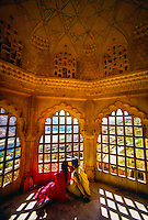 Women admire the view from inside the Amber Fort near Jaipur, Rajasthan, India