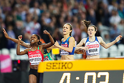 London, 2017 August 07. Their faces say it all as Faith Chepngetich Kipyegon, Kenya, reacts with fierce passion as she wins the women's 1,500m final; Jennifer Simpson, USA, glances at the timing screen and Laura Muir, Great Britain can't hide her disappointment on day four of the IAAF London 2017 world Championships at the London Stadium. © Paul Davey.