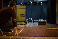 SLIEMA, MALTA - 8 FEBRUARY 2016: (L-R) Stage managers Adam Moore and Dave McEvoy take measure as they set up the stage of the touring Hamlet performed by the Shakespeare's Globe theatre company at the Salesian Theatre in Sliema, Malta, on February 8th 2016.<br /> <br /> The touring Hamlet, performed by the Shakespeare's Globe theatre company, is part of the Globe to Globe tour that set off in April 2014 (on the 450th anniversary of Shakespeare's birth) with the ambitious intention of visiting every country in the world over 2 years. The crew is composed of a total of sixteen men and women: four stage managers and twelve twelve actors  actors perform over two dozen parts on a stripped-down wooden stage. So far Hamlet has been performed in over 150 countries, to more than 100,000 people and travelled over 150,000 miles. The tour was granted UNESCO patronage for its engagement with local communities and its promotion of cultural education. Hamlet was also played for many dsiplaced people around the world. It was performed in the Zaatari camp on the border between Syria and Jordan, for Central African Republic refugees in Cameroon, and for Yemeni people in Djibouti. On February 3rd it was performed to about 300 refugees in Calais at the camp known as the Jungle.