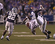 Florida Atlantic tight end Jason Harmon (88) is airborn as Kansas State defenders  Antwon Moore (43) and Justin McKinney (22) move in for the tackle in the second half, at Bill Snyder Family Stadium in Manhattan, Kansas, September 9, 2006.  The Wildcats beat the Owls 45-0.
