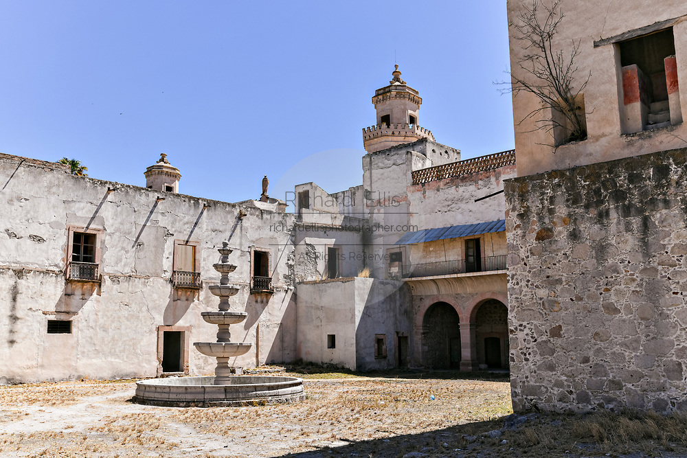A secondary courtyard looking toward the front at the fading Hacienda de Jaral de Berrio in Jaral de Berrios, Guanajuato, Mexico. The abandoned Jaral de Berrio hacienda was once the largest in Mexico and housed over 6,000 people on the property and is credited with creating Mescal.