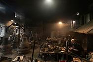 Agnone, Molise - General view of the Marinelli Pontificial foundry in Agnone, a small town in Molise region. On the right the bell master Antonio Delli Quadri.<br /> <br /> Ad Agnone, la tradizione di forgiare e fondere i metalli rislae a 2500 anni fa, al Medioevo. La fonderia Marinelli, con oltre otto secoli di attivit&agrave;, &egrave; l&rsquo;officina in cui vengno prodotte camoane pi&ugrave; antica del mondo. Ad oggi i Marinelli continuano questa secolare tradizione forgiando campane dai bellissimi rilievi artistici e dalla perfetta sonorit&agrave;. Nel 1924, Papa Pio XI, concesse alla famiglia Marinelli di effiggiarsi dello stemma Pontificio.<br /> Ph. Roberto Salomone