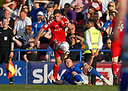 Jason Pearce of Charlton Athletic clears from Steven Davies of Rochdale during the EFL Sky Bet League 1 match between Rochdale and Charlton Athletic at Spotland, Rochdale, England on 5 May 2018. Picture by Paul Thompson.