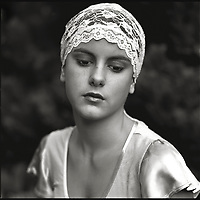 A young woman wearing a lace headband