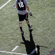 Jack Reid #18 of the Boston Cannons warms up on the field prior to the game at Harvard Stadium on May 17, 2014 in Boston, Massachuttes. (Photo by Elan Kawesch)